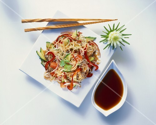 Asian rice noodle and vegetable salad with soy sauce