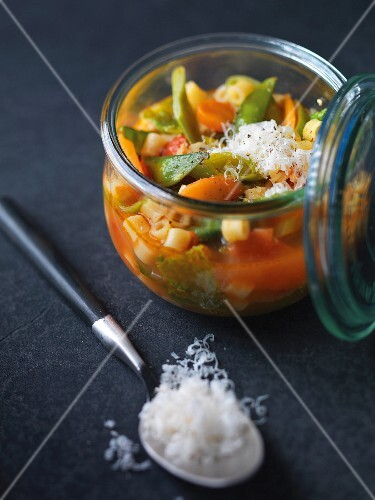 Minestrone soup with Parmesan cheese in a preserving jar