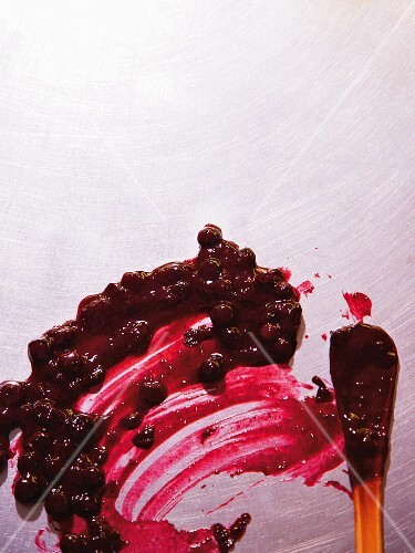 Cherry compote spread on a metal surface