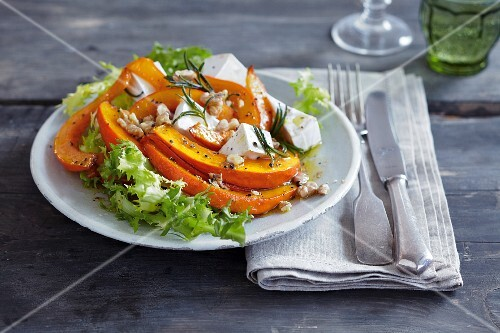 Pumpkin wedges with Camembert on a bed of lettuce