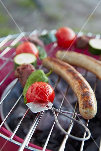 Vegetable and skewers on a barbecue