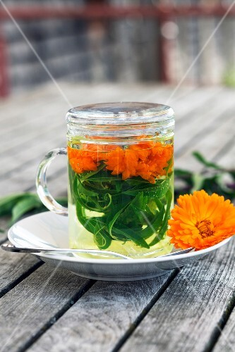 Herbal tea with marigolds and verbena in a tea glass