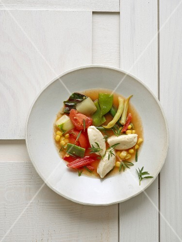 Tomato-infused vegetable stew with quark dumplings