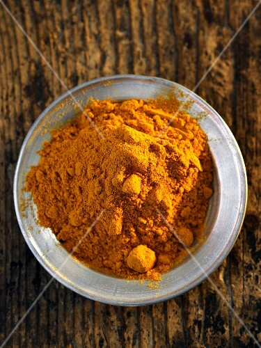 A plate of turmeric powder (seen from above)