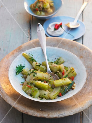 Braised cucumbers with dill and chilli peppers