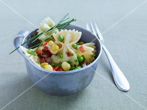 Colourful pasta salad with peas, sweetcorn, chives and diced salami