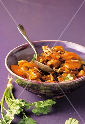 Stir-fried saffron chicken with slivered almonds, carrots and coriander