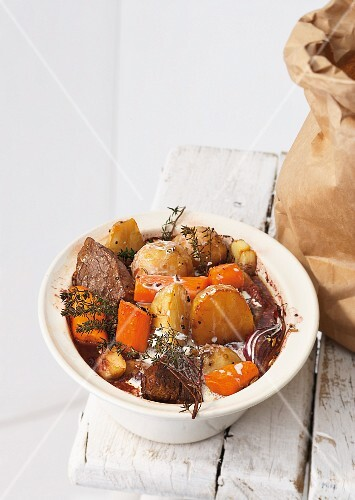 Jerusalem artichokes in red wine with beef and carrots
