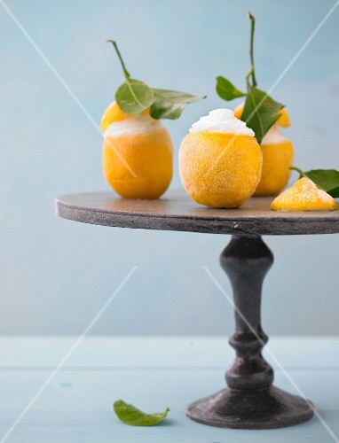 Lemon frozen dessert with filled cream kept on serving dish