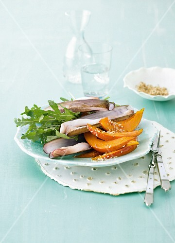 Razor clams with a rocket salad and pumpkin wedges
