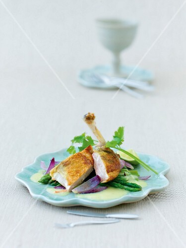 Guinea fowl with Thai asparagus on plate