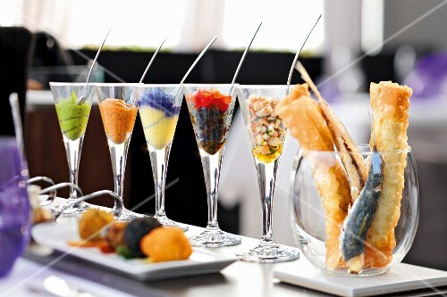 Various appetisers in glasses