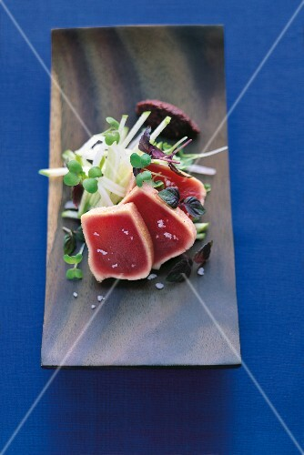 Mesclun Salad with roasted tuna, apple and cress on serving tray
