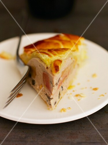 A sliced of truffled veal tart