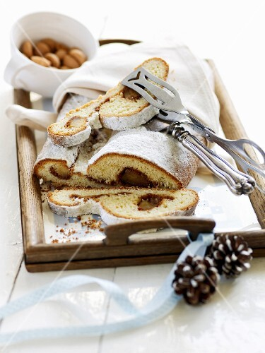 Stuffed almond stollen on a tray
