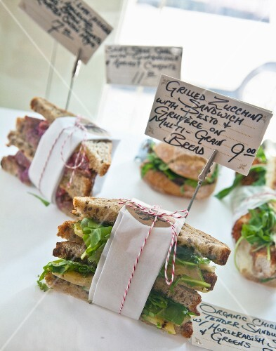 Various sandwiches with price labels