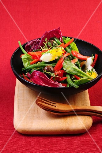 Colourful salad with beans, eggs and olives