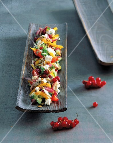 Farmer's salad with poppy seed oil dressing and redcurrants