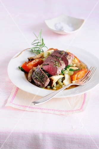 Noisette of lamb with herbs on a bed of vegetables