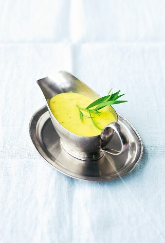 Béarnaise sauce with tarragon in a gravy boat
