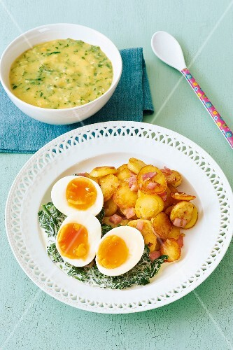 Potato and spinach baby food and a plate of fried potatoes and eggs