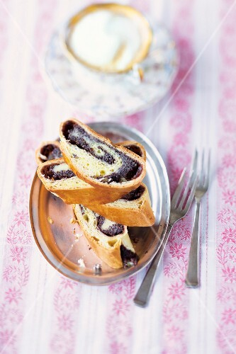 Yeast strudel filled with quark, poppyseeds and plum sauce (Austria)