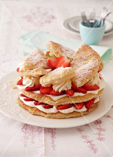 A puff pastry cake with strawberries and cream