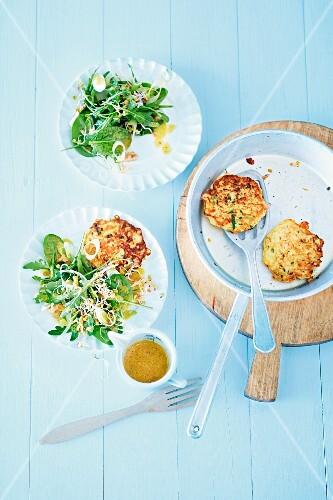 Courgette cakes with a spinach salad and radish sprouts