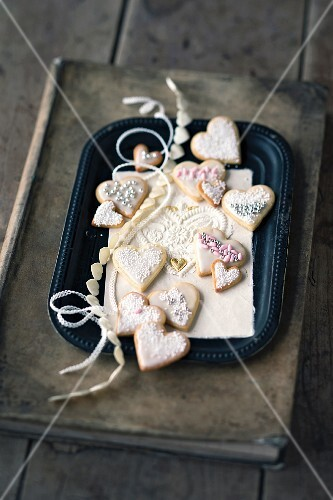 Heart-shaped lemon biscuits decorated with sugar pearls and sprinkles