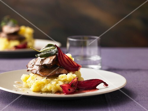 Sage duck liver with mashed apples and potatoes and onion relish