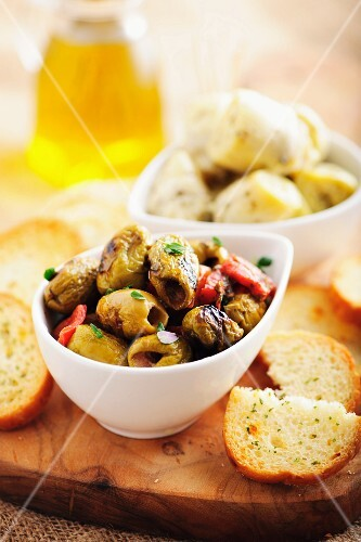 Grilled olives and artichokes with white bread (Spain)
