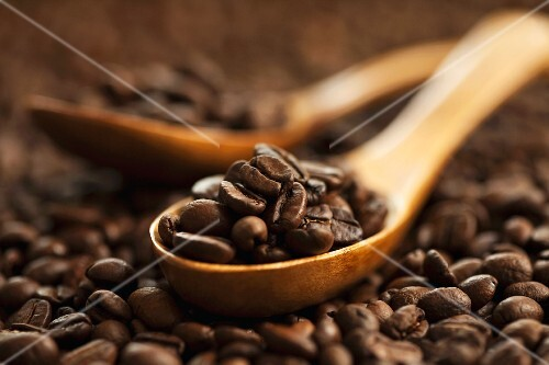 Coffee beans on a wooden spoon