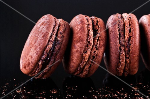 A row of chocolate macaroons