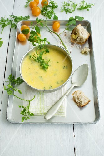 Cream of yellow tomato soup with homemade potato bread