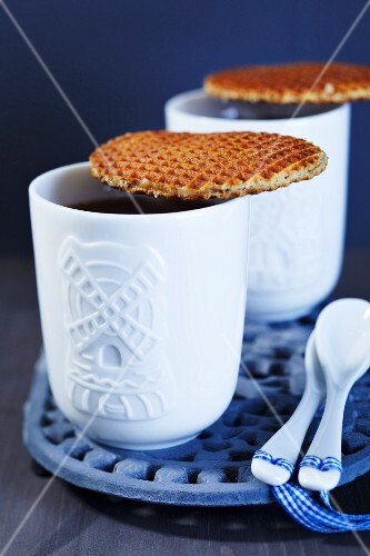 Waffle biscuits and tea in Dutch cups decorated with windmills