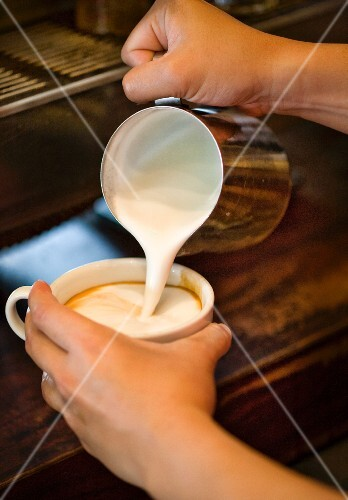 Making a Latte; Pouring Steamed Milk