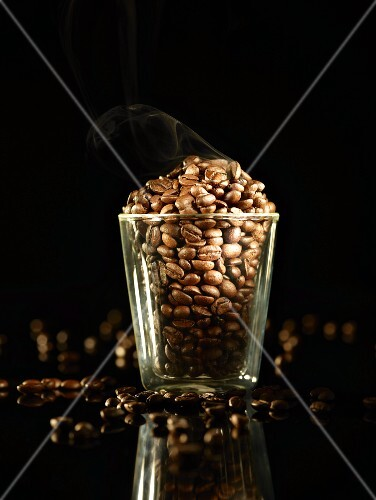 A glass of roasted coffee beans