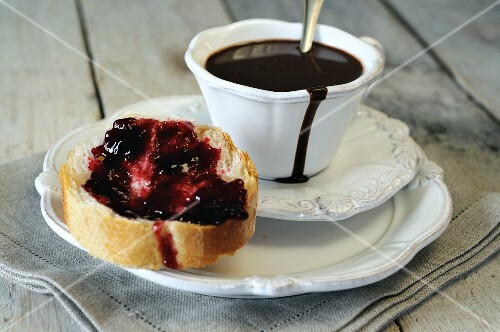 Bread and jam and a cup of hot chocolate
