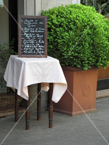 A menu at the entrance of a restaurant (Milan, Italy)