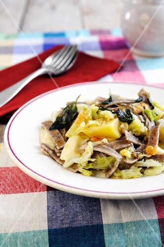 Buckwheat pasta with potatoes, cabbage and taleggio cheese