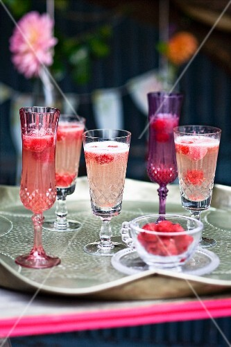 Champagne cocktails with raspberries