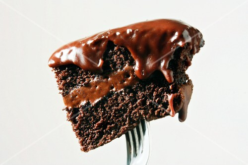 Piece of Chocolate Cake with Chocolate Frosting on a Fork