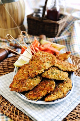 Breaded chicken breast with a cheese, parsley and pine nut crust