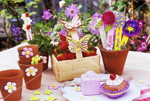 Homemade floral decorations and berry basket with butterflies