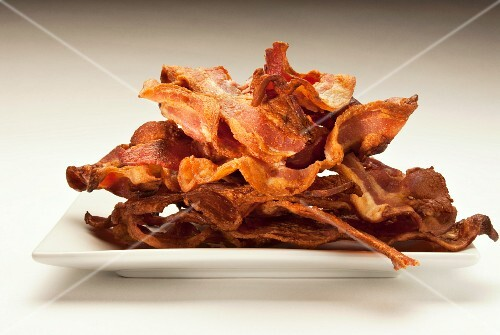 Crispy Bacon Strips Piled on a Dish