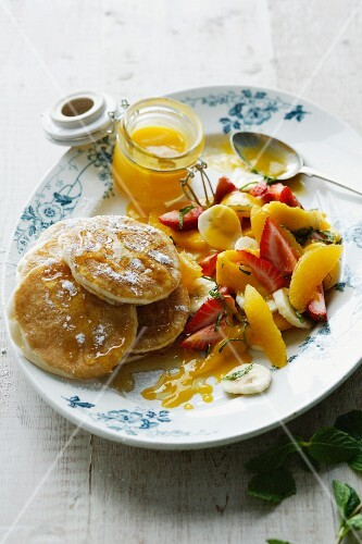 Plate of pancakes with fruit salad