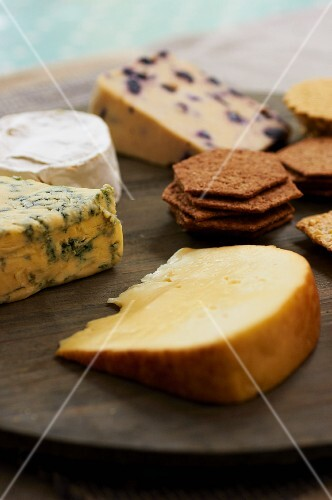 A cheese platter with crackers