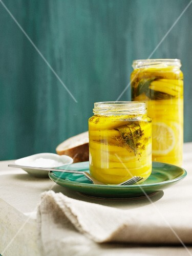 Jars filled with lemons and oil