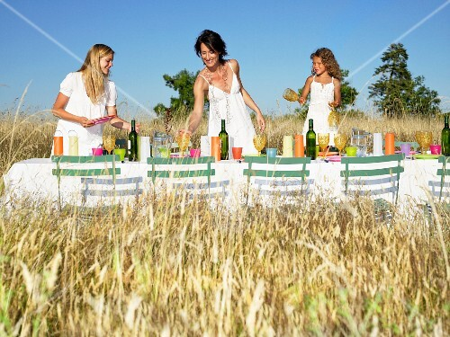 Girls setting the table, outdoors