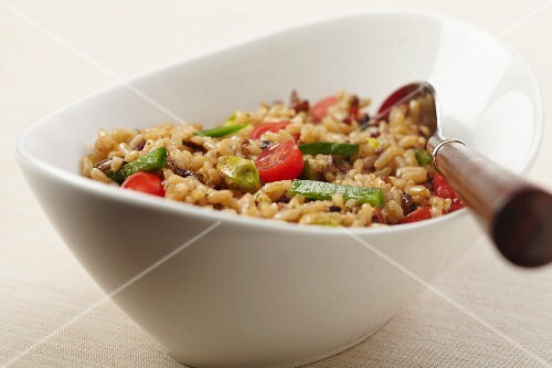 Bowl of Brown Rice with Cherry Tomatoes, Green Pepper and Pistachios